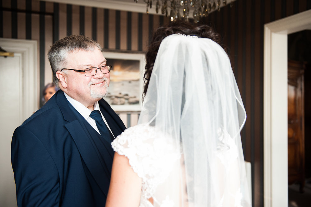Father of the bride seeing his daughter for the first time on her wedding day. Eaves Hall wedding photography