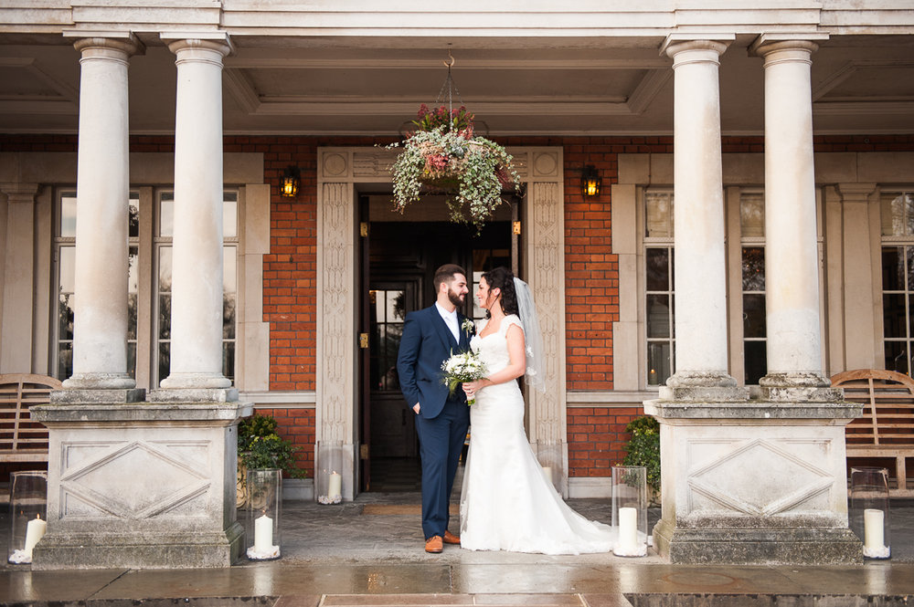 Bride and groom outside at Eaves Hall. Natural wedding photography