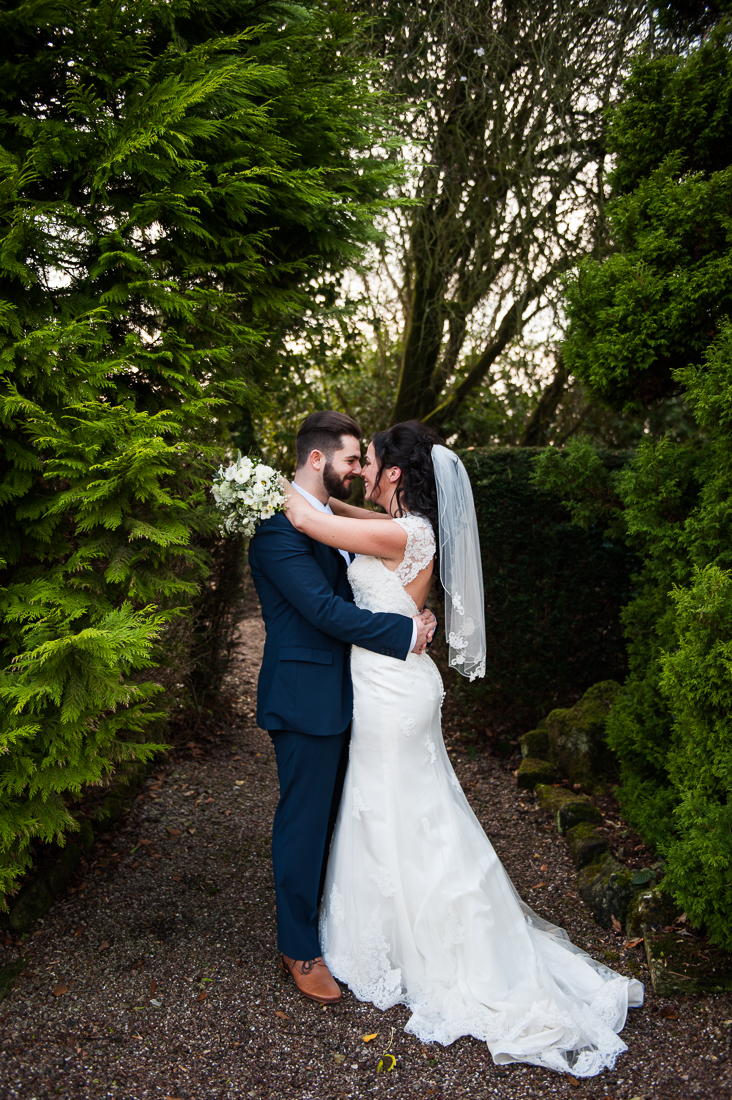 Romantic portrait of the bride and groom kissing. Lancashire wedding photography