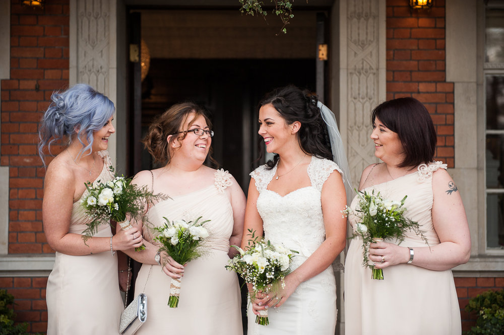 natural shot of bridesmaids laughing