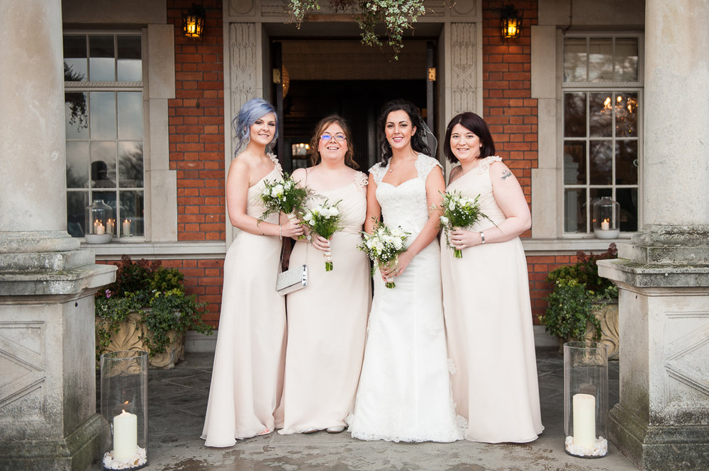 Natural shot of the bride and bridesmaids outside at Eaves Hall