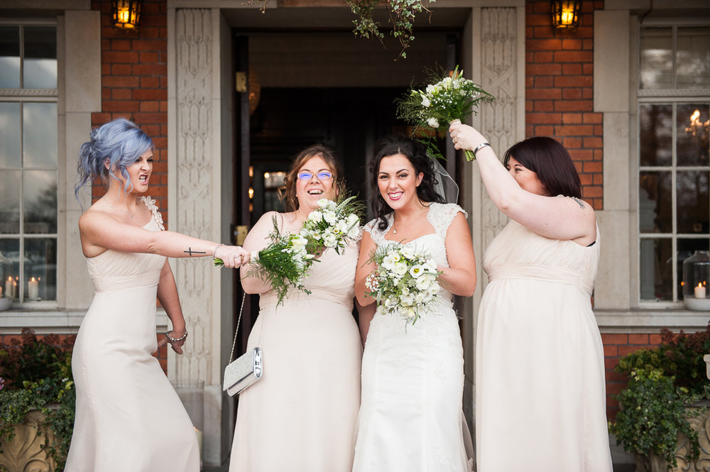 Fun portrait of the bridal party at Eaves Hall