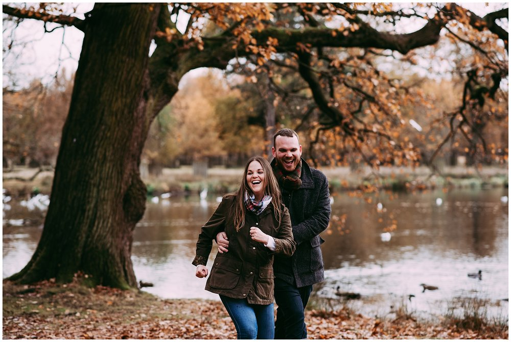 Natural photograph of couple running through woods at Dunham Massey, Altrincham