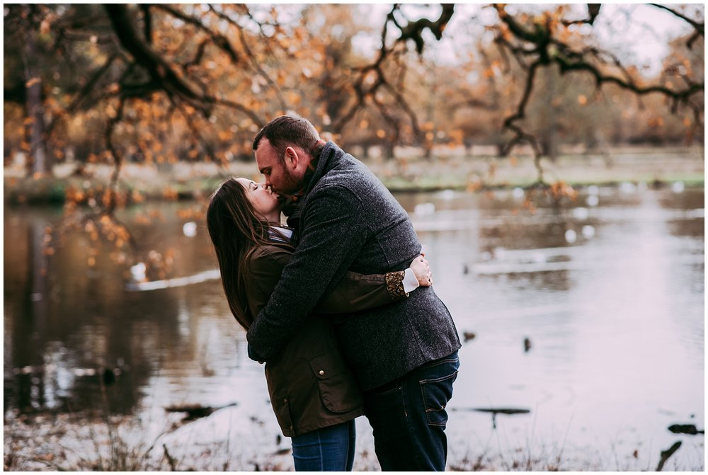 natural photo of couple kissing lakeside. Cheshire lifestyle photography