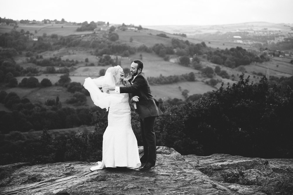 Natural shot of brides veil blowing in the wind. Yorkshire wedding photography.