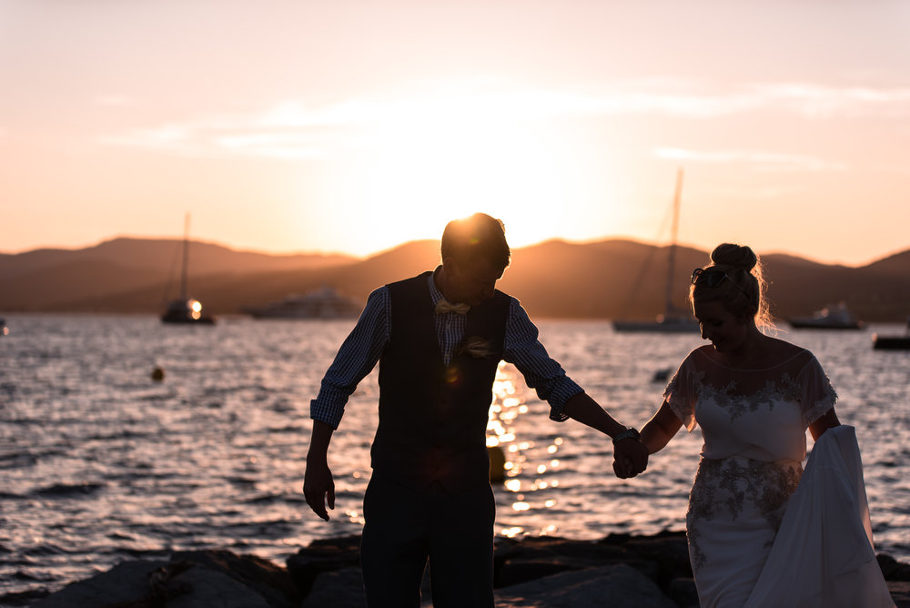 Silhouette of bride and groom at sunset on the beach in Saint Tropez. Destination Wedding Photographer
