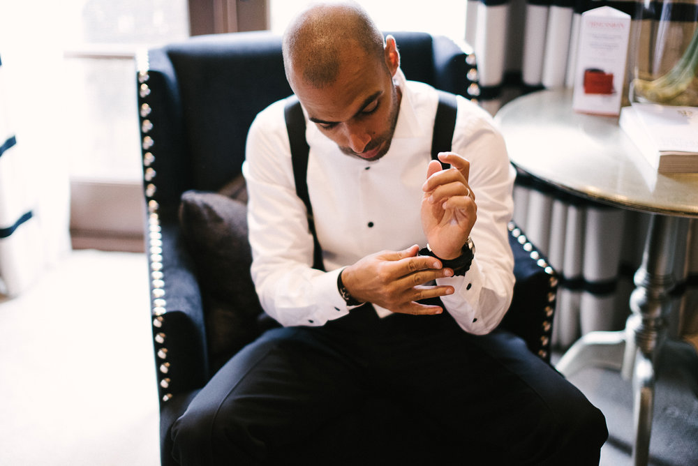 Groom putting on his watch before the wedding at Northcote Manor. Lancashire wedding photography