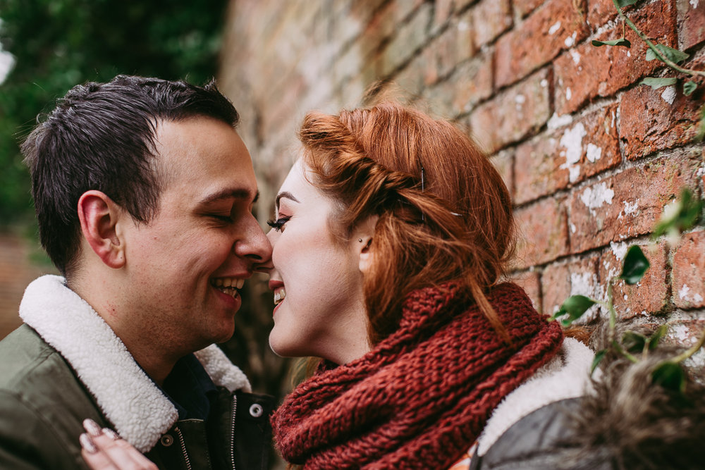 Close up of couple kissing at Haigh Hall, Wigan