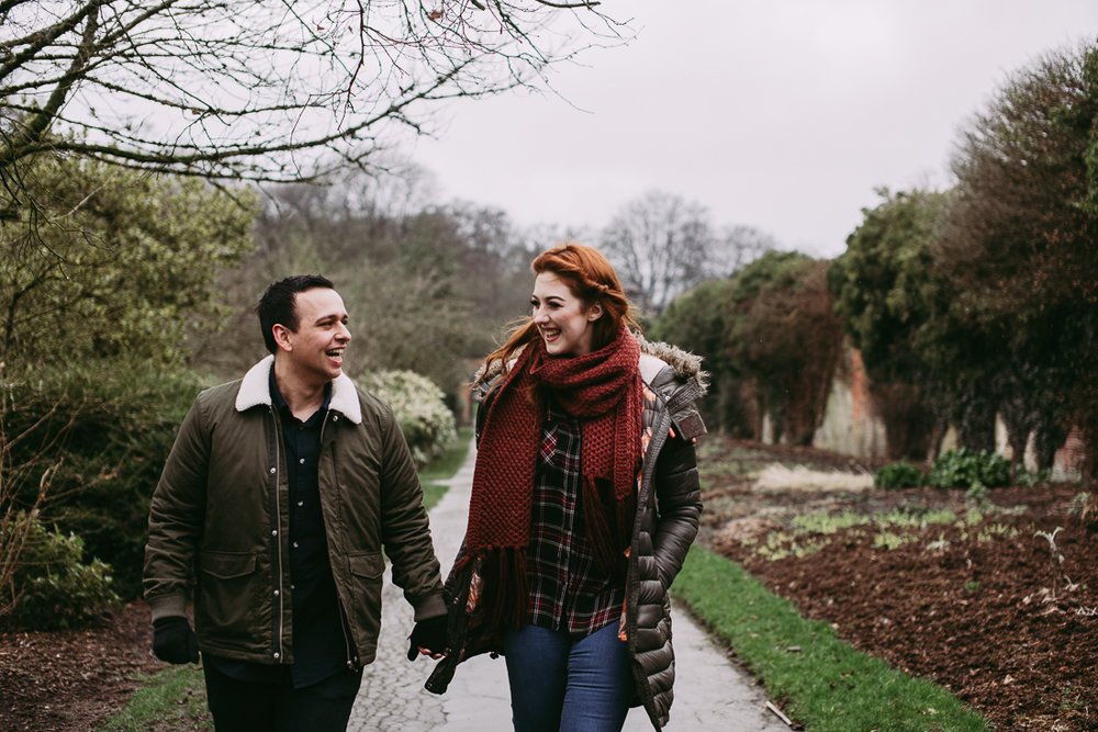relaxed photography of couple walking hand in hand