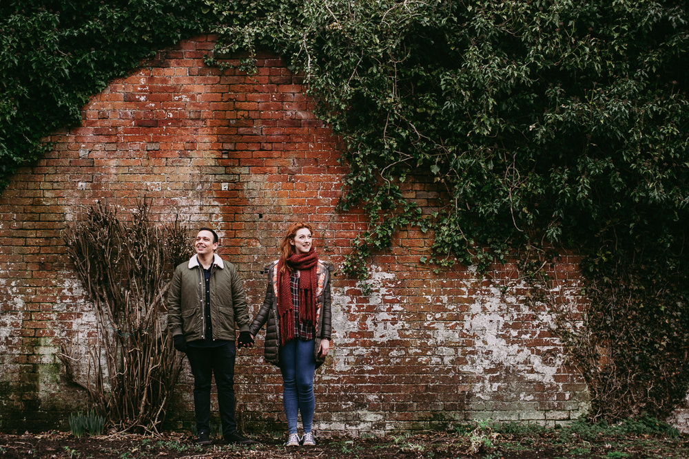 Engagement photoshoot at Haigh Hall. Bride and groom to be in the gardens