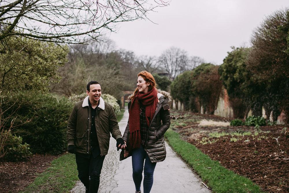 Natural shot of couple walking together at Haigh Hall, Lancashire