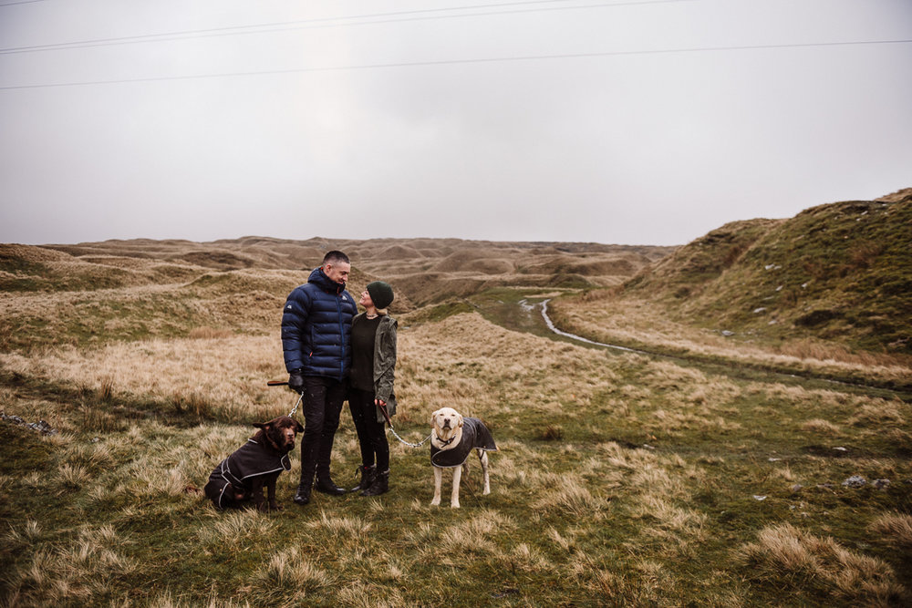 Landscape shot of couple and their dogs with the Lancashire moor in the background