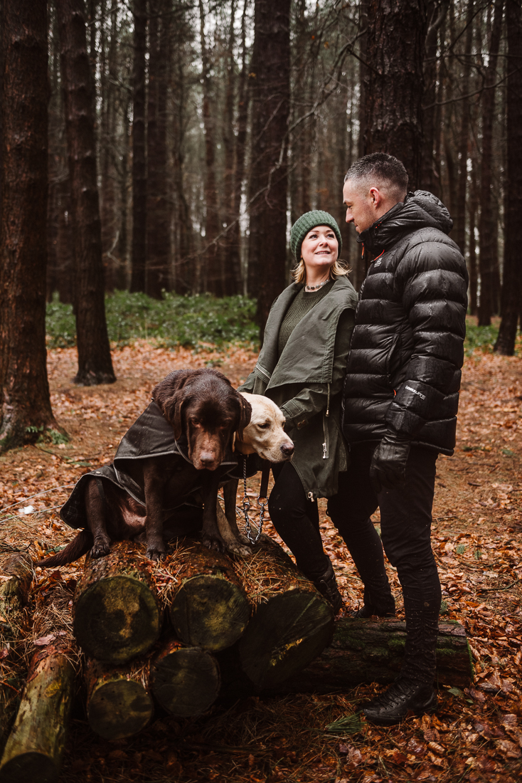 Portrait in the woods with couple and their dogs at Hurstwood, Burnley, Lancashire.