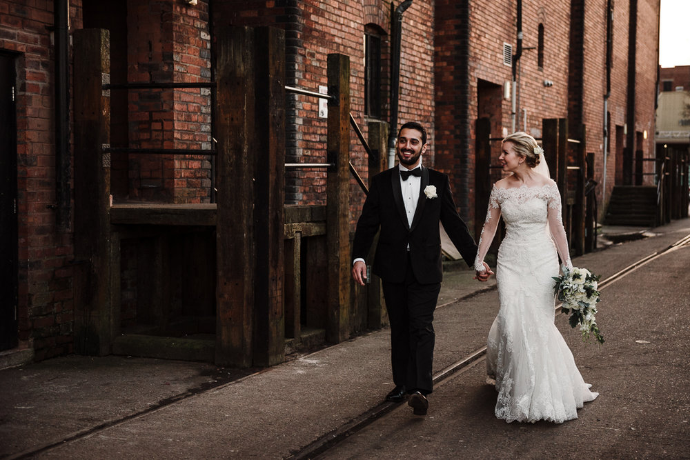 bride and groom outside Victoria Warehouse. Manchester wedding photography