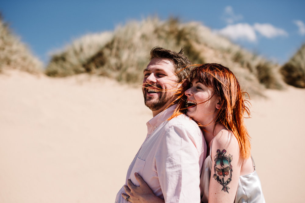Natural shot of couple laughing. Liverpool wedding photography