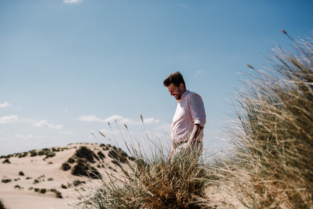 Natural shot of the groom. Beach wedding photography