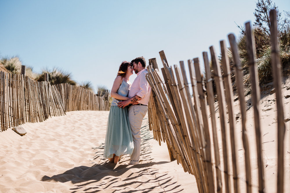 Couple kissing. Beach wedding photography
