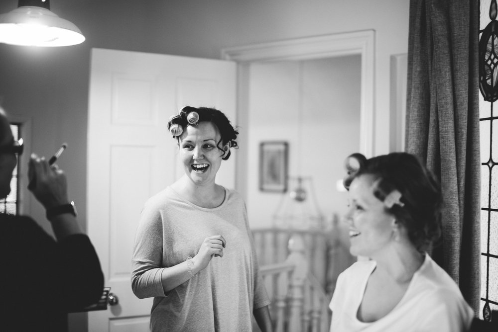 Natural shot of getting ready. Cornwall wedding photography.