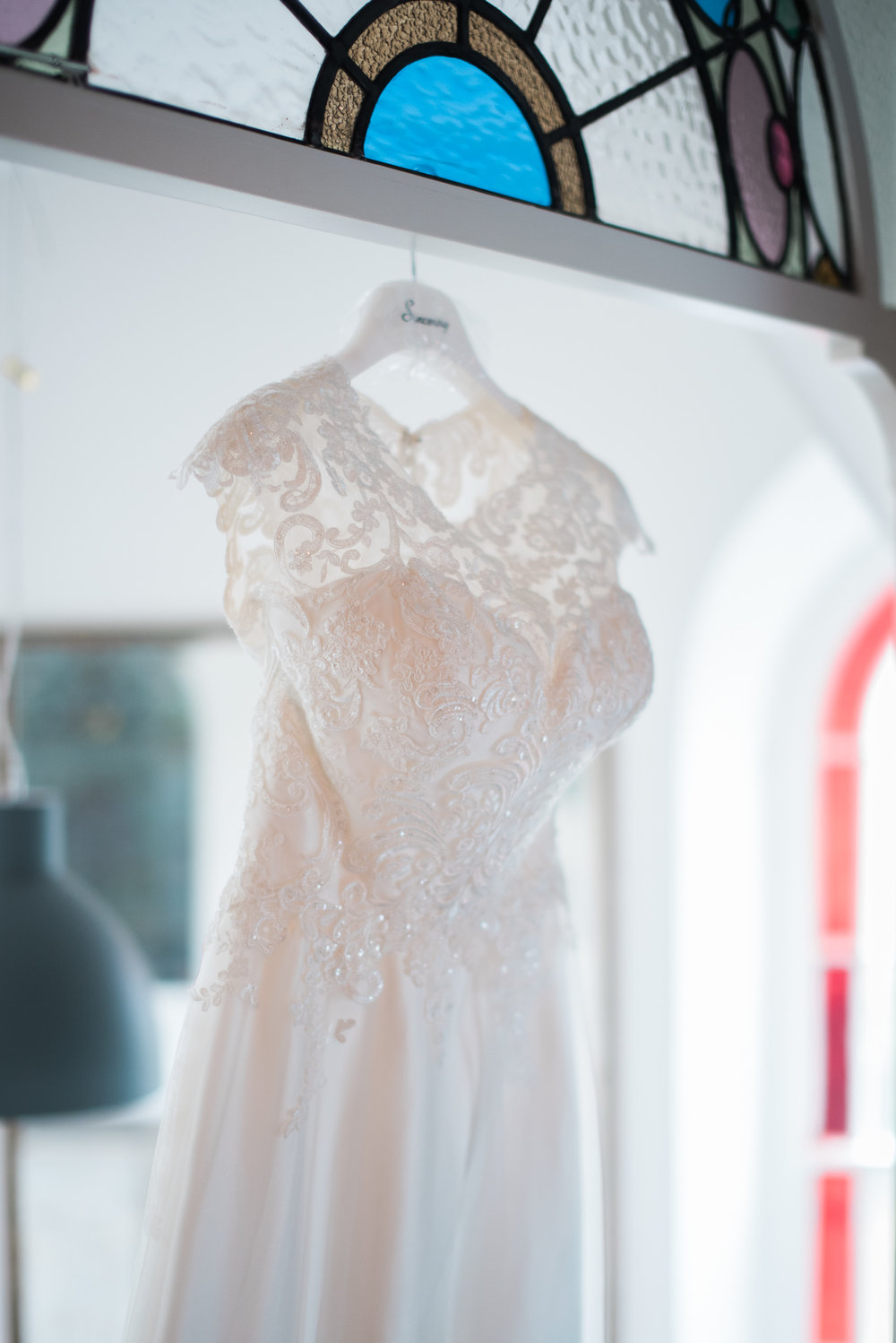 Detailed shot of lace on wedding dress