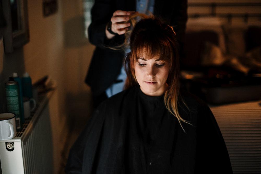 Bridesmaid getting hair put up