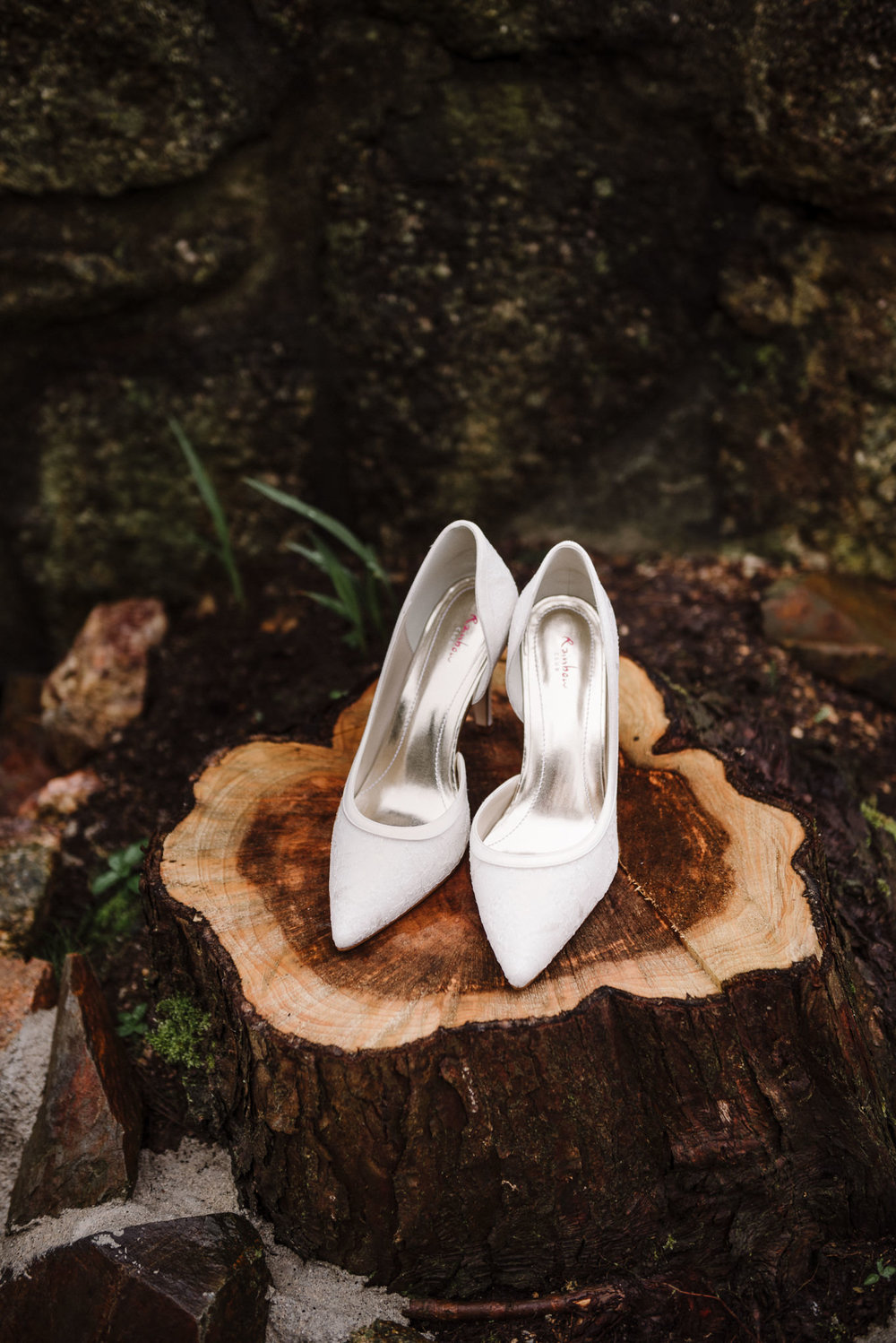 Brides shoes on a log outside of the Dreamcatcher in Cornwall
