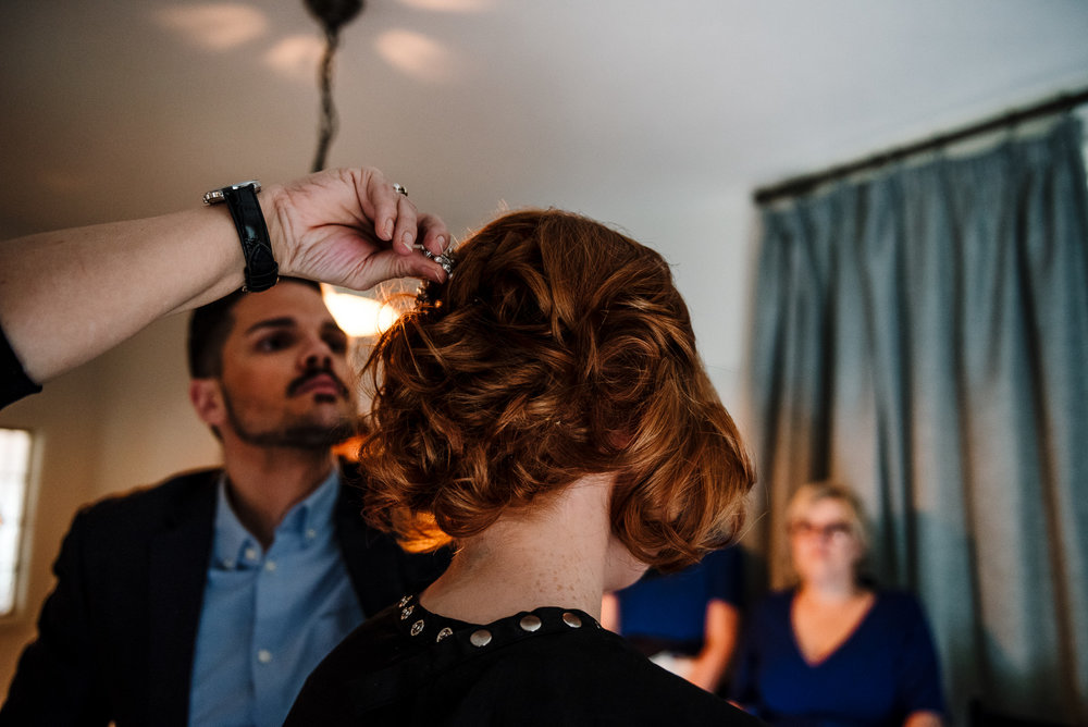 Natural shot of bride getting ready