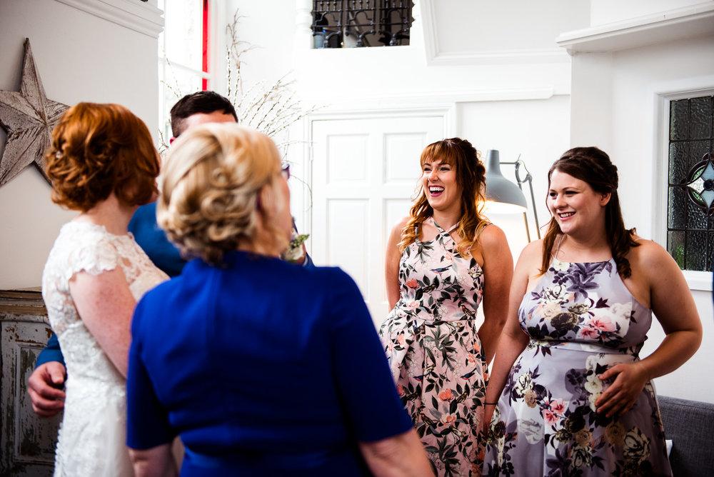 Natural shot of guests laughing.