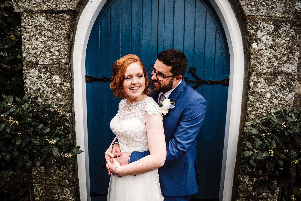 Stylish portrait of the bride and groom outside at the Dreamcatcher.