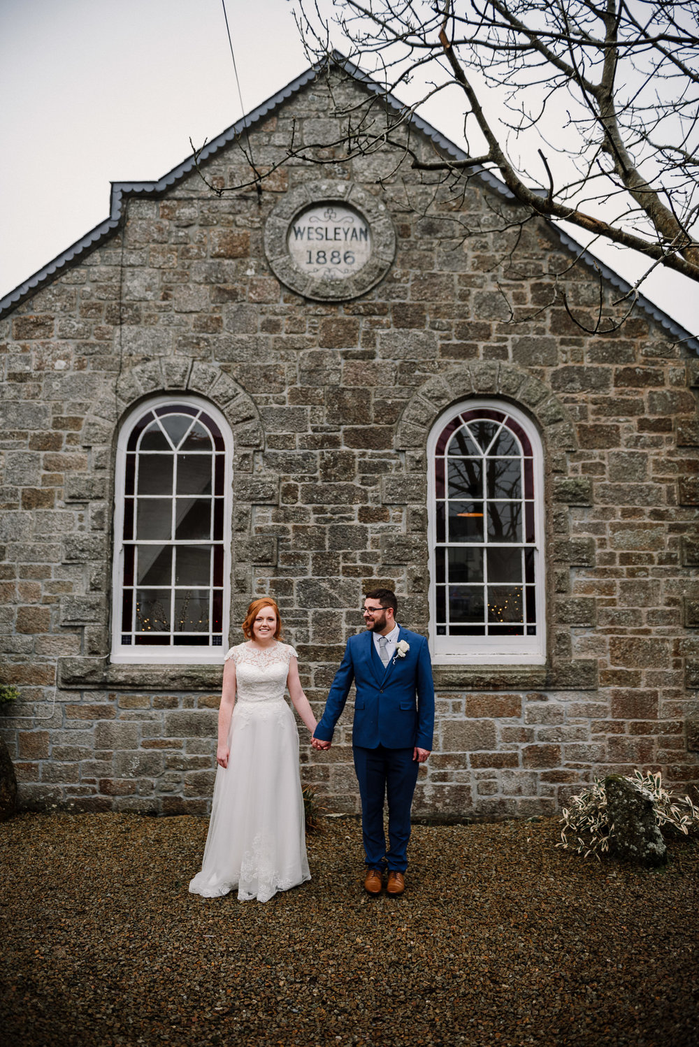 Bride and groom stood together outside the Dreamcatcher Wedding Venue in Cornwall. Elopement wedding photography.