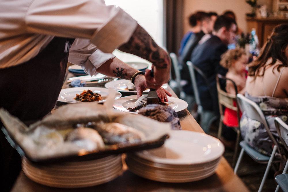 Documentary shot of meal prep durning wedding breakfast.
