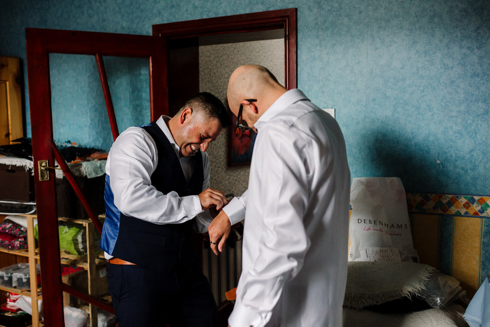 Groomsmen getting ready at home.