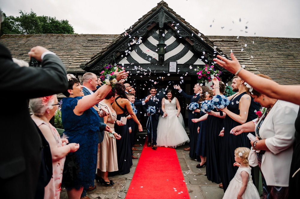 Confetti outside of Rivington Hall Barn. Natural wedding photography
