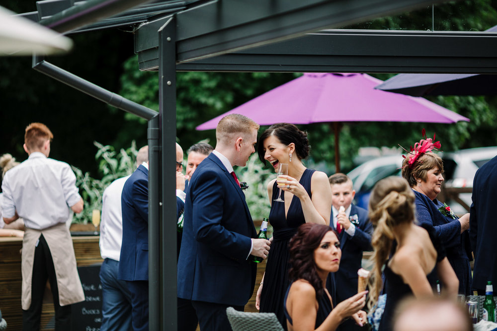 Natural shot of guests outside at Rivington Hall Barn.
