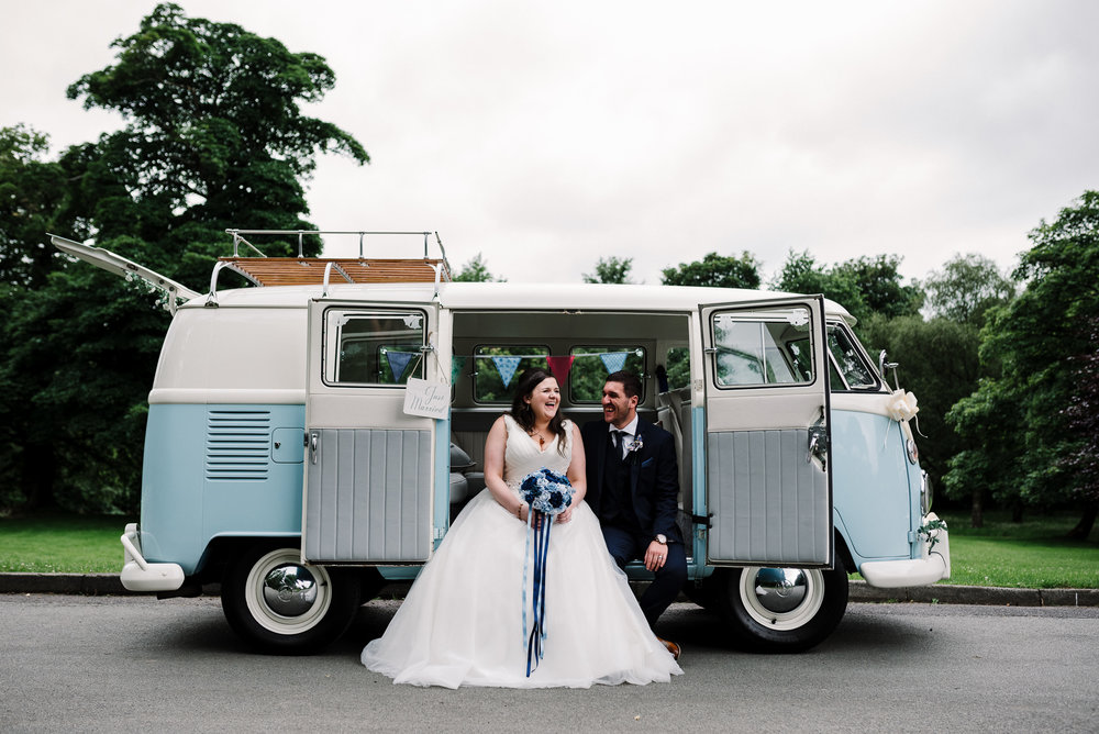 Bride and groom together outside VW camper van. Lancashire wedding photography.