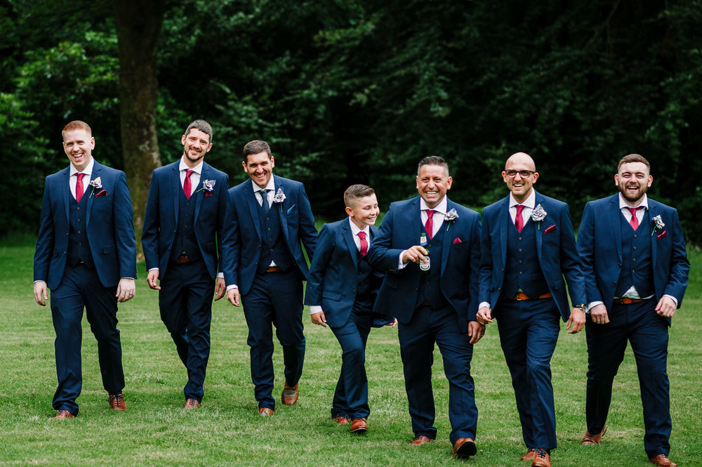 Natural shot of groomsmen together. Rivington Hall Barn wedding photography.