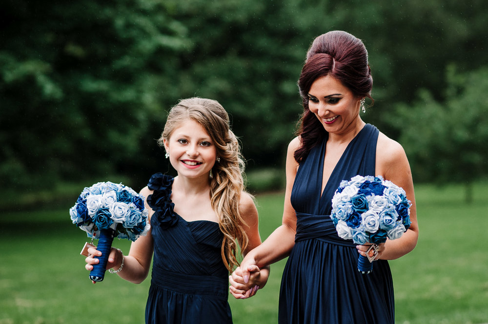Natural shot of bridesmaid and flower girl together.