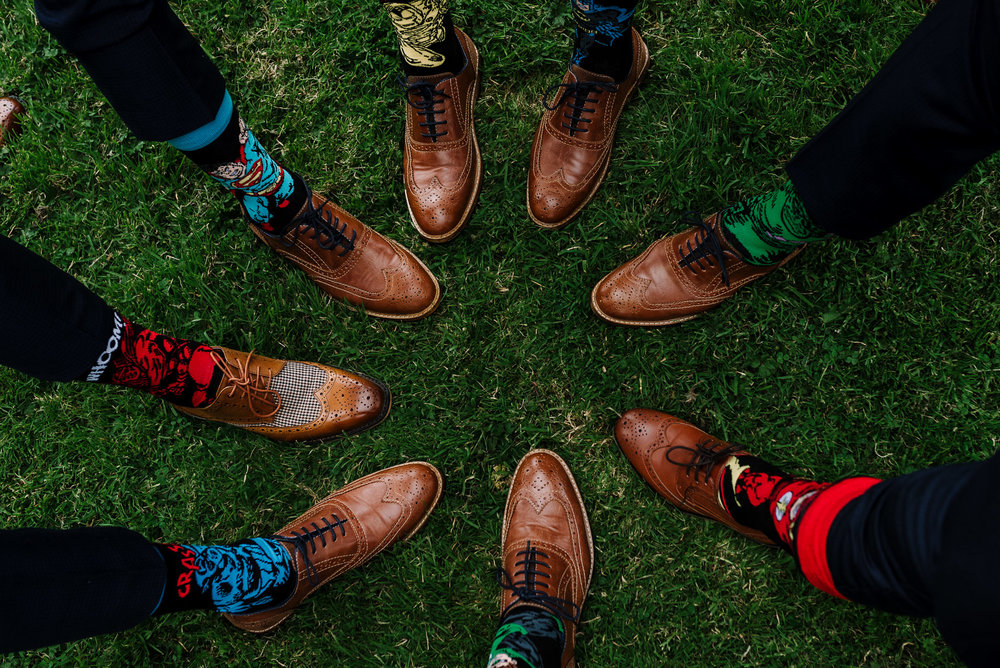 Superhero themed wedding. Groomsmen socks.