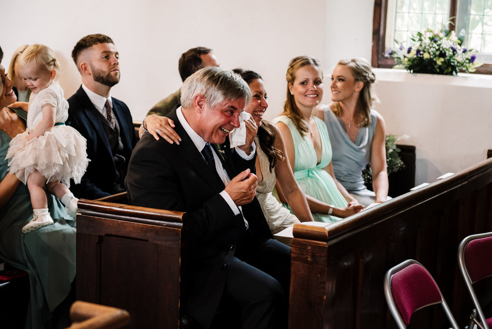 Father of the bride crying during ceremony. Lake district wedding photography.