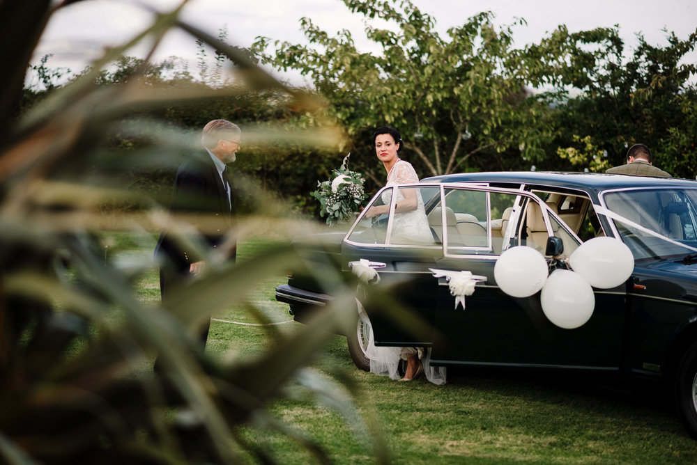Bride and groom arriving at their farm wedding. Lake District wedding photography
