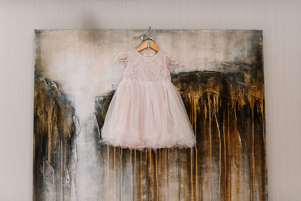 Fower girls dress hung on a picture frame