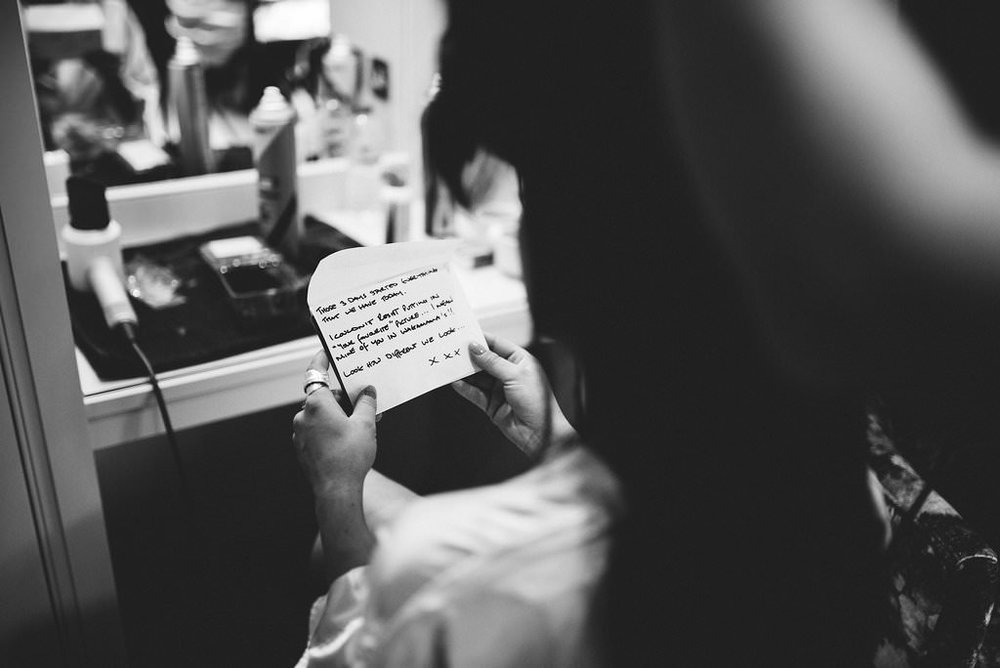 Black and white photo of a note from the groom