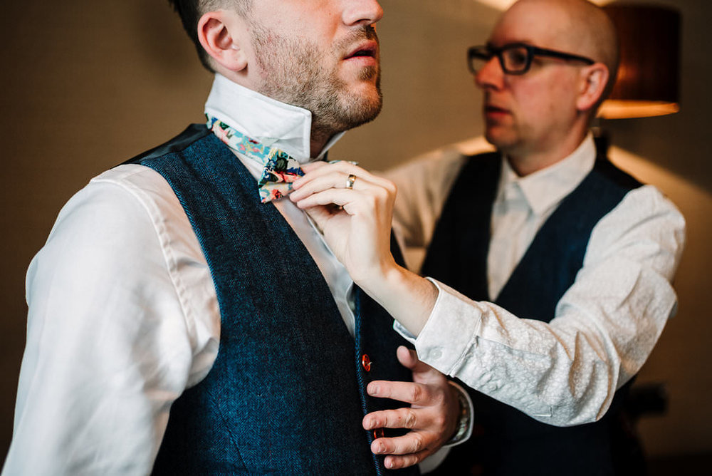 Natural shot of groomsmen getting ready at Stanley House Hotel