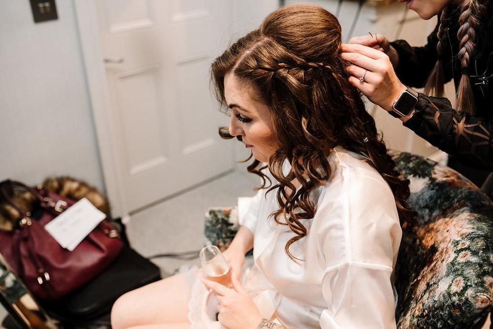 Bride having her hair curled