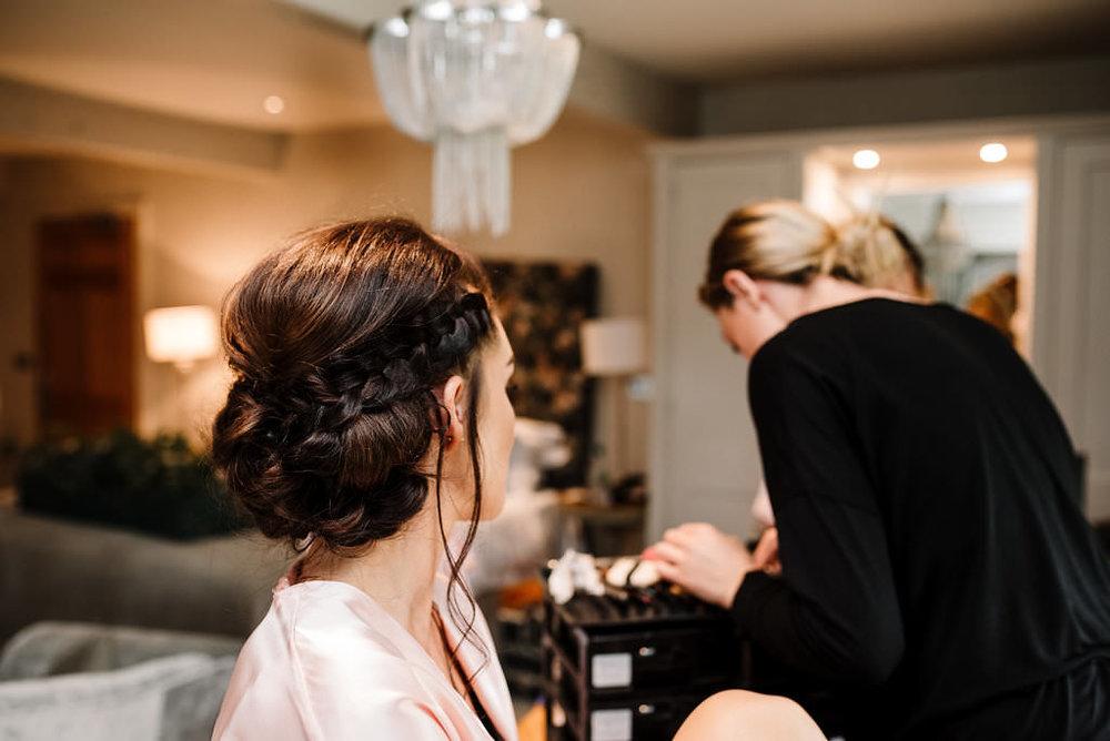 detailed shot of bridesmaids stylish hairstyle braid. Stanley House hotel wedding photography
