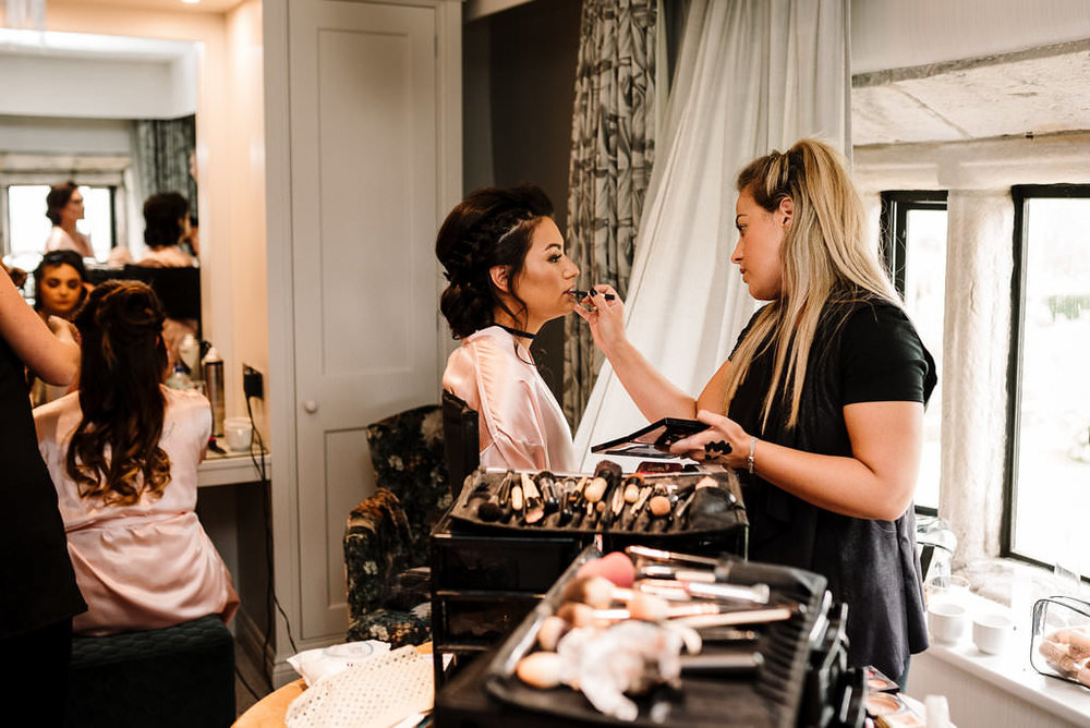 bridesmaid having her makeup applied