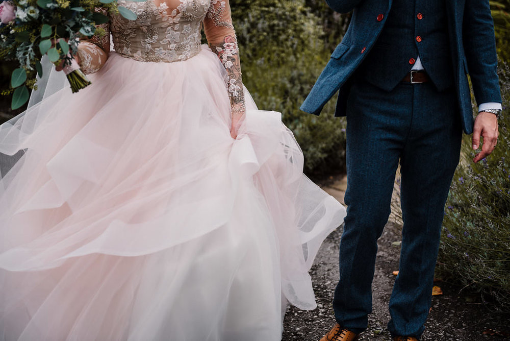 detailed shot of wedding dress and suit