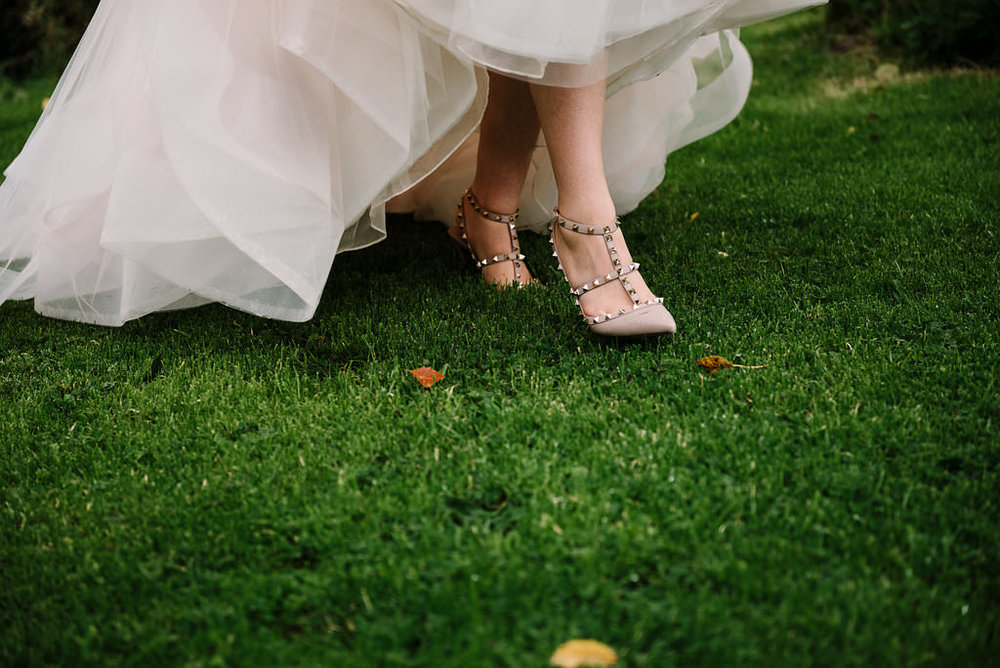 Close up of brides Valentino shoes as she's walking