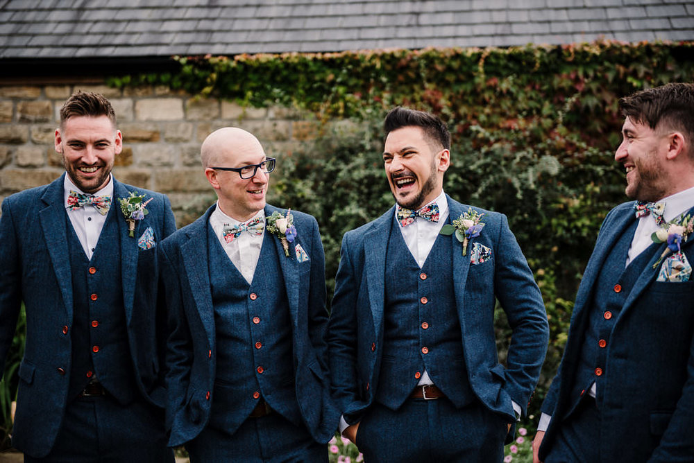 groomsmen walking together outside Stanley House. Ribble Valley wedding photography