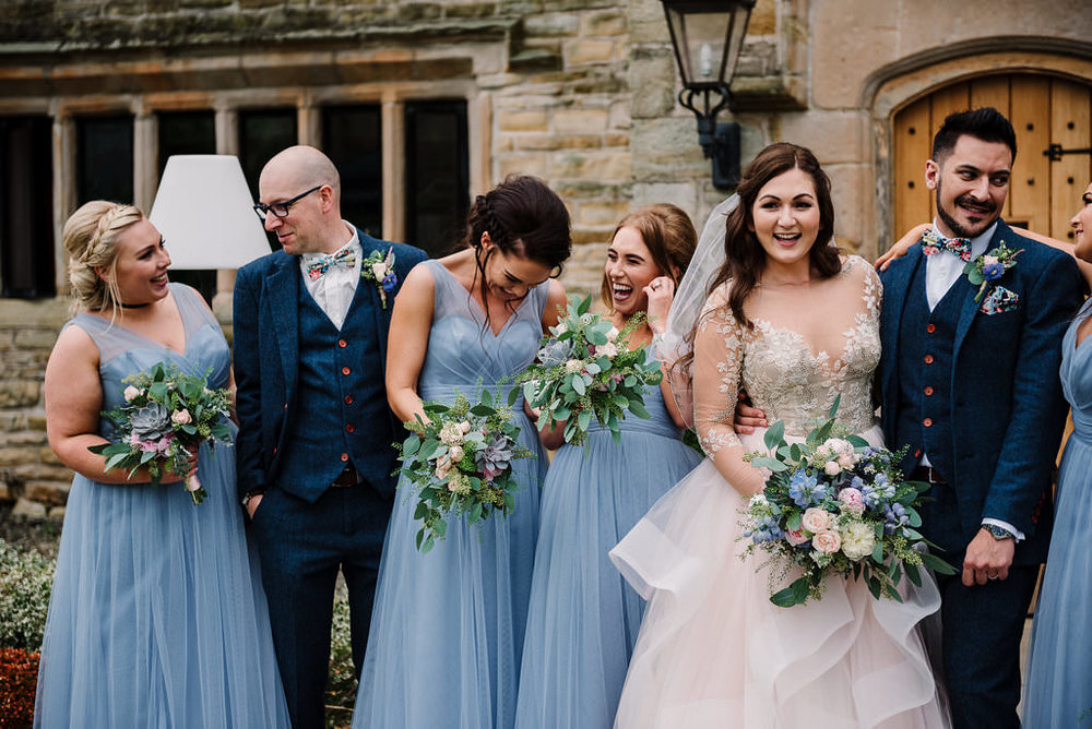 relaxed photo of bridal party chatting.
