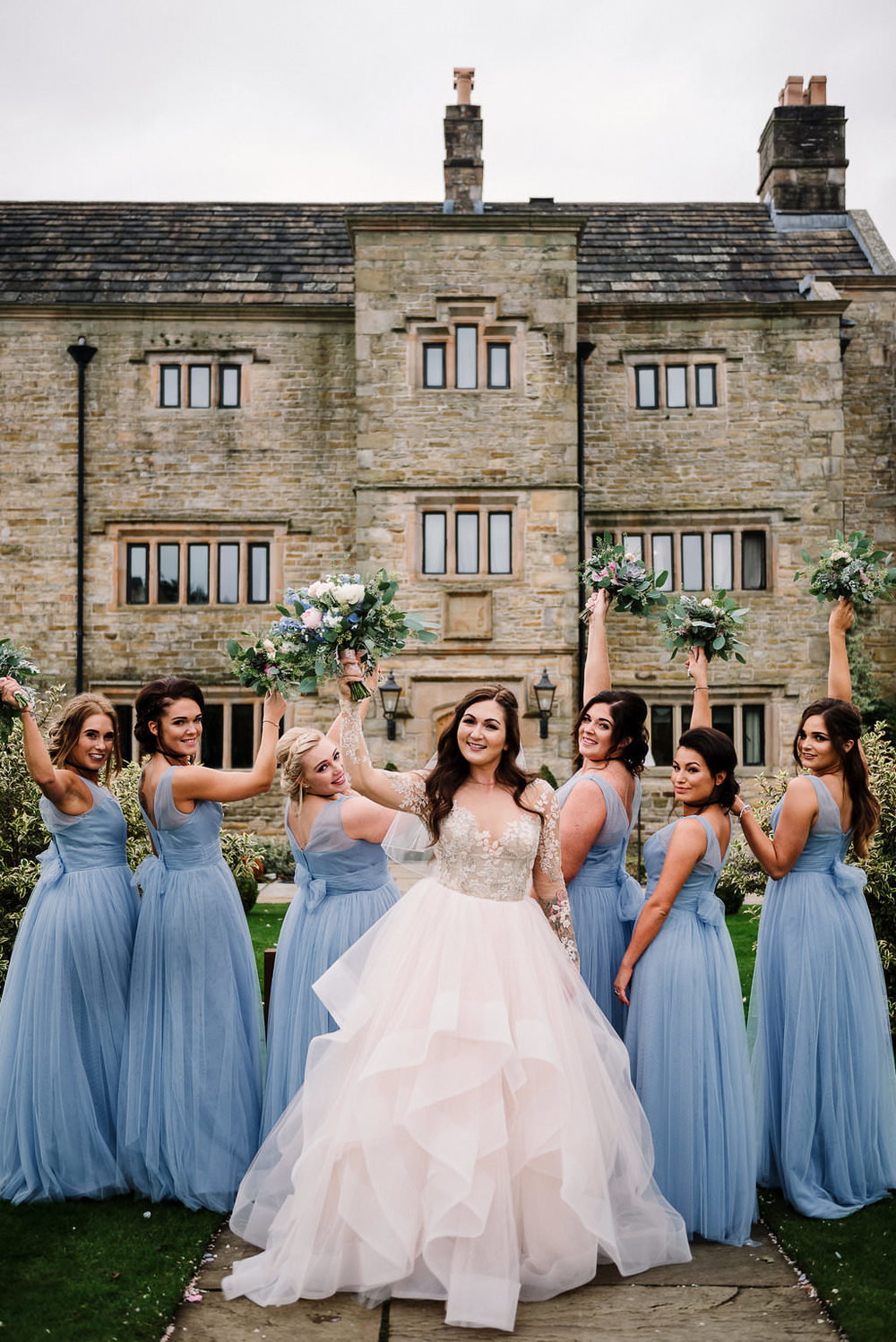 Fun shot of bride and bridesmaids together. Ribble Valley wedding photography